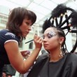 Visagiste makes makeup for model with punk hairstyle at XVII International Festival World of Beauty 2010 — Stock Video