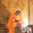 Stock Video: Worker weld metal gratings by acetylene torch