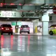 Several cars ride away from underground parking garage — Stock Video #29830977