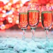 Three glasses champagne or white wine stand sprinkled snow — Stock Video