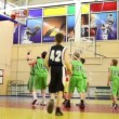 Team Rune and undefined team play basketball in the basketball hall — Stock Video