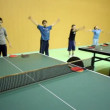 Vídeo Stock: Several boys warm up before training in ping-pong