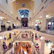 People walk along boutiques on multiple floors shopping center Atrium — Vídeo Stock