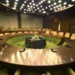 Stock Video: Empty conference room with ring tables and rows of chairs, shown around
