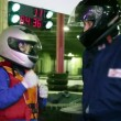 Boy and trainer in racing helmets hit his fists into hand — Stock Video #29831667