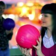 Boy and girl hold bowling balls and smile, and then make strike — Stock Video #29831681