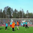 Stock Video: People play soccer with big inflated ball, competition Great Race 2010