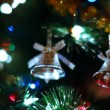 Two toy bells hang on Christmas tree among of blinking colored garlands — Stock Video
