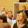 At conference people listening to speech, and interpreter translates it — Stockvideo
