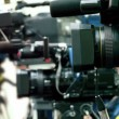 Operator prepare equipment in row of few cameras — Vídeo Stock