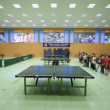 Spacious gym with tables for table tennis and trainer with children standing in row — Vidéo