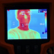 Stock Video: Hand hold thermal image camera, on-screen humface