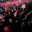 People dance hands up at rave party in congested large hall — Stock Video #29832367