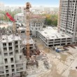 Construction site in foreground of cityscape — Stok video