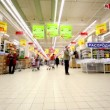 People walk at hypermarket Auchin trade center Troika — стоковое видео #29832661