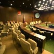 Stock Video: Empty conference room with ring tables and rows of chairs