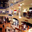 Customers walk along boutiques on multiple floors trade center Atrium at Kurskaya — Video Stock
