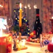 Decorated christmas dining table with bottle, glasses, candy, candles — Stock Video