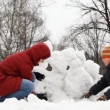 Mother with little son make snow fortress — Video Stock