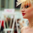 Blonde model with intricate hairdo at XVII International Festival World of Beauty 2010 — Stock Video
