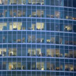 Stock Video: Numerous offices behind windows of office building