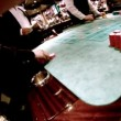 Stock Video: Casino craps table, people sit at table with chips