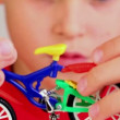 Boy hold toy bike in front of his face — Stock Video