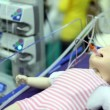 Dummy of little child with tube from suction unit in mouth at medical box — Stock Video
