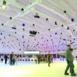 Many people skate on ice rink with colored illumination in shopping center — Stock Video