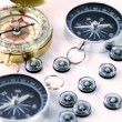 Nine small black plastic compasses, two big and one vintage golden — Stock Video