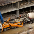 Stock Video: Car-crane and car-concrete mixer on building site