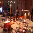 Stock Video: Room with decorated christmas dining table with bottle, glasses, candy, candles