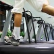 Legs man quickly run on one of many treadmill in large gym — Stock Video