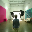 Boy walk across photo studio among spotlights — Stock Video