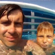Close-up of father and son, which swim in swimming pool — Stock Video #29834145