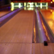 Girl throw bowling ball on middle lane of three in club — Stock Video #29834171