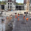 Stock Video: Many builders in action at construction site