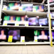 Many tv sets stay working on showcase in hypermarket — Vídeo de stock #29834457