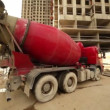 Concrete mixer stand near unfinished building — Stock Video