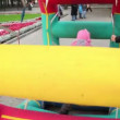 Girl walk in inflated wheel in park at autumn day at Bolotnaysquare — Stock Video #29834801