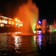 Stock Video: Boat quickly moves along Moscow River near beautiful lighted fountain