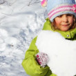 Little girl hold heart made of snow and stand on trail — Stock Video