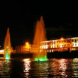 Stock Video: Boat moves along Moscow River near beautiful lighted fountain