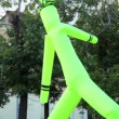 Inflated man dance at background of trees on City Day — Vidéo