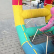 Girl walk in inflated wheel in park at autumn day at Bolotnaya square — Video