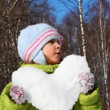 Cute little girl hold heart made of snow — Stock Video