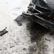 Stock Video: Strongly battered car is on icy road with flashing emergency lights and around wreckage