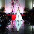 Model in wedding dress walks catwalk at Evening of French fashion — Stock Video