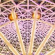 Ferris wheel with flashing lights under arch of roof at nightclub — Stock Video