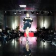 Model in dress with cape on her shoulders walks catwalk at Evening of French fashion — Stock Video